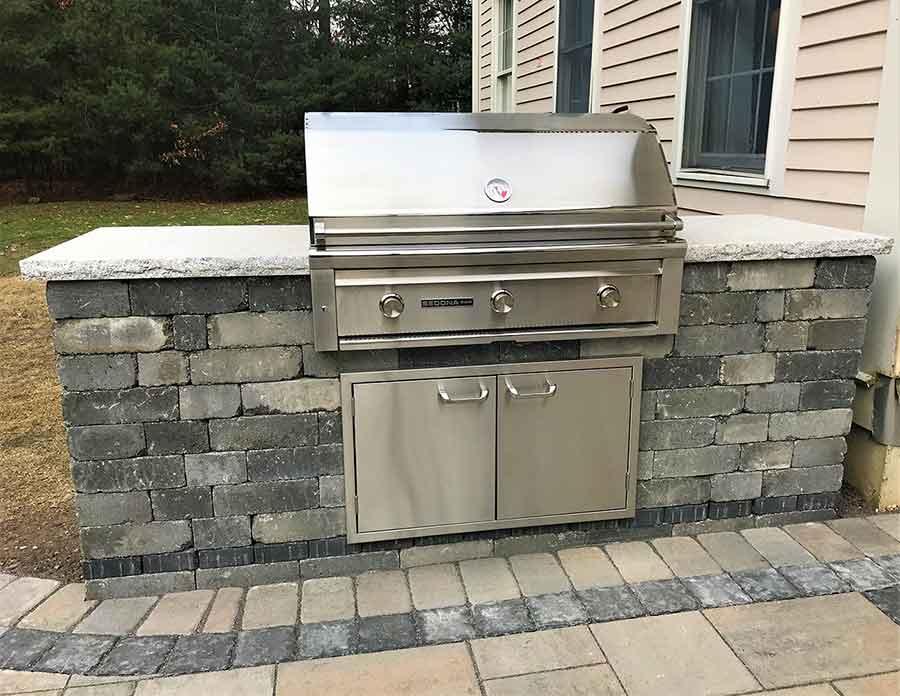 Amazing outside custom built grill in back yard.