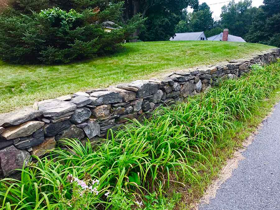 Field stone retaining wall in front yard.