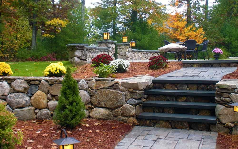 Beautiful natural stone hardscape walkway, steps, patio, and walls.