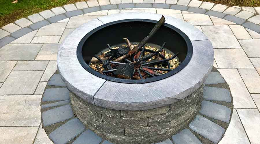 Stunning circular outdoor fire pit and patio.