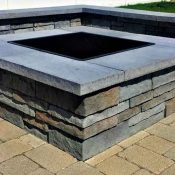 Square outdoor fire pit on patio.