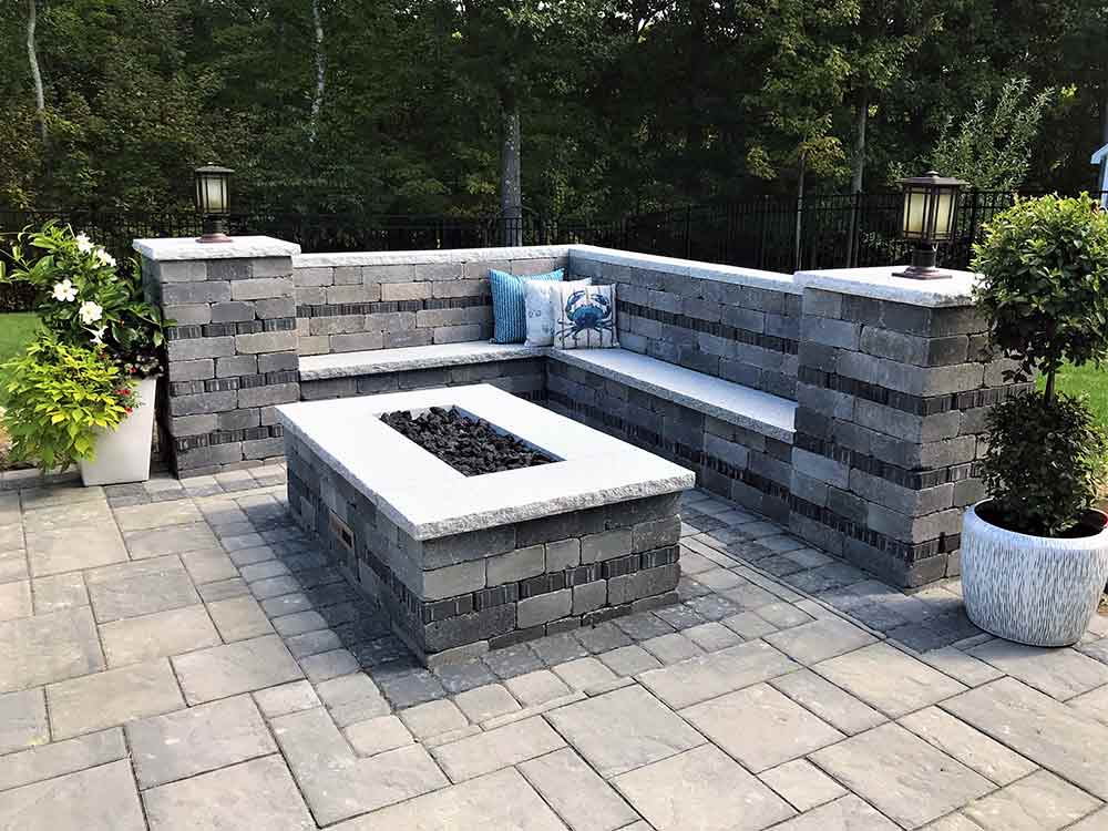 Custom outdoor fire pit and patio with columns.