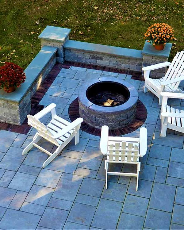 Patio with fire pit and wall.