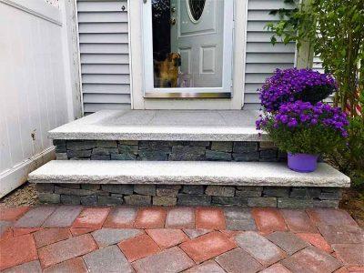 Veneer stone steps with granite treads.