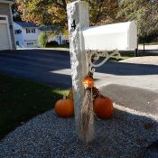 granite mailbox post with bracket in front yard
