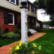 granite lamp post in front yard for lighting