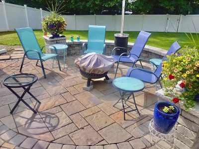Outdoor living entertainment backyard fire pit and patio.