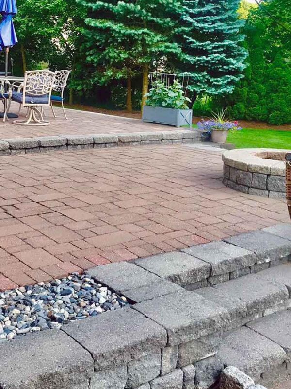 back yard paver patio entertaining space with fire pit