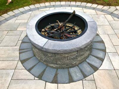 back yard outdoor fire pit and paver patio for entertaining