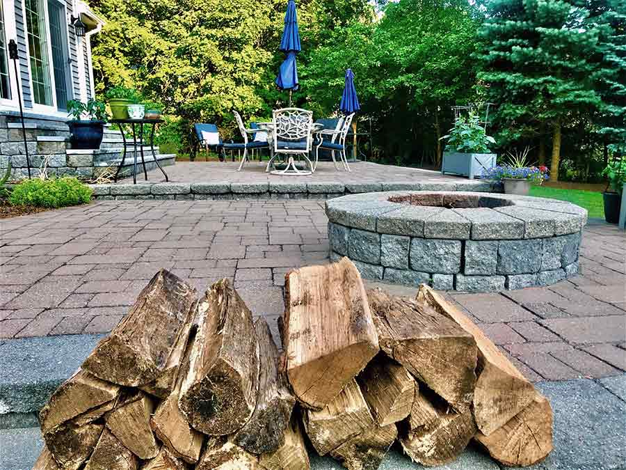 home back yard landscape paver patio and fire pit