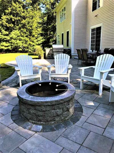home back yard patio with outdoor fire pit and grill