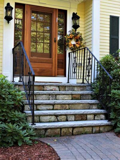 front entryway with natural stone steps, granite treads and paver walkway