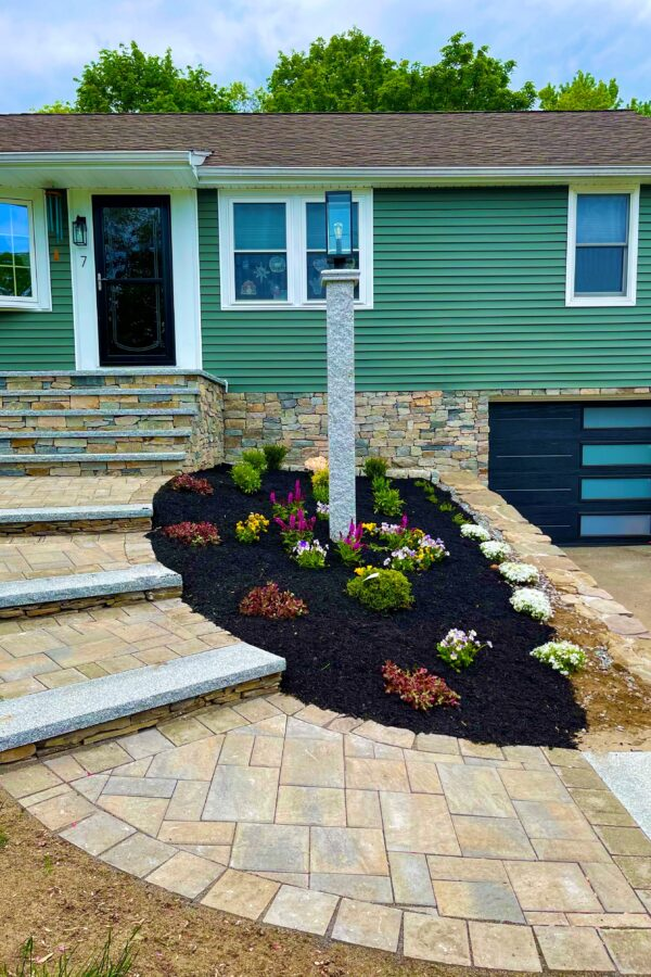 veneer stone foundation with steps and granite capped walkway