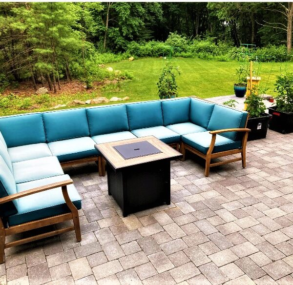 outdoor paver patio for entertaining with plantings and furniture