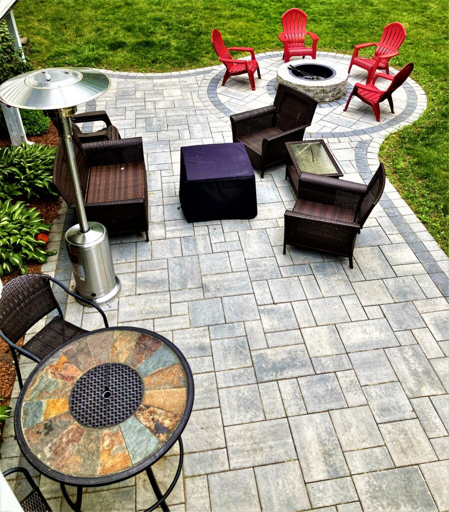 outdoor entertaining paver patio with fire pit and furniture