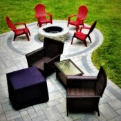outdoor back yard paver patio with circular fire pit
