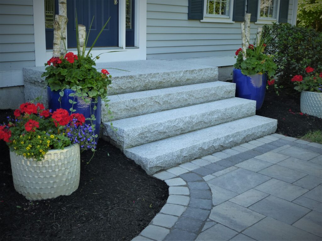 granite front entryway with paver walkway