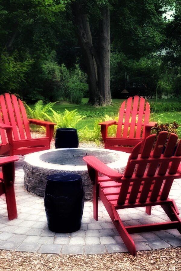 circular paver patio with fire pit for outdoor entertaining